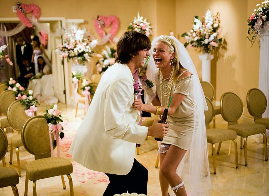 """In this image released by 20th Century Fox, Ashton Kutcher plays Jack Fuller, left, and Cameron Diaz plays and Joy McNally in a scene from, """"What Happens in Vegas."""" Photo: K.C. Bailey, AP"""