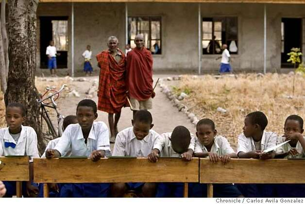 ###Live Caption:Children line up patiently under the trees on their school desks at Three Hills School in Mdori, Tanzania on Tuesday October 30, 2007, as they wait to be treated by Dr. Frank Artress's volunteer medical staff. Dr. Frank Artress, a former cardiac anesthesiologist from Modesto, Calif., survived a nearly fatal climb on Mount Kilimanjaro nearly five years ago. Since then, he and his wife Susan have returned to Tanzania to heal the people of the country they grew to love and call home. Their work is done for free, through a charitable organization Frank and Susan founded.  Photo by Carlos Avila Gonzalez / San Francisco Chronicle###Caption History:Children line up patiently under the trees on their school desks at Three Hills School in Mdori, Tanzania on Tuesday October 30, 2007, as they wait to be treated by Dr. Frank Artress's volunteer medical staff. Dr. Frank Artress, a former cardiac anesthesiologist from Modesto, Calif., survived a nearly fatal climb on Mount Kilimanjaro nearly five years ago. Since then, he and his wife Susan have returned to Tanzania to heal the people of the country they grew to love and call home. Their work is done for free, through a charitable organization Frank and Susan founded.  Photo by Carlos Avila Gonzalez / San Francisco Chronicle###Notes:Notes, Contacts, Name CQ's here###Special Instructions:MANDATORY CREDIT FOR PHOTOG AND SAN FRANCISCO CHRONICLE/NO SALES-MAGS OUT Photo: Carlos Avila Gonzalez