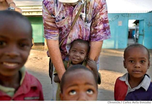 ###Live Caption:Dr. Frank Artress plays with several street children in Minjingu, Tanzania on Monday, October 29, 2007. Artress makes medical visits to the African bush to treat tribal villages and impoverished communities. Dr. Frank Artress, a former cardiac anesthesiologist from Modesto, Calif., survived a nearly fatal climb on Mount Kilimanjaro nearly five years ago. Since then, he and his wife Susan have returned to Tanzania to heal the people of the country they grew to love and call home. Their work is done for free, through a charitable organization Frank and Susan founded.  Photo by Carlos Avila Gonzalez / San Francisco Chronicle###Caption History:Dr. Frank Artress plays with several street children in Minjingu, Tanzania on Monday, October 29, 2007. Artress makes medical visits to the African bush to treat tribal villages and impoverished communities. Dr. Frank Artress, a former cardiac anesthesiologist from Modesto, Calif., survived a nearly fatal climb on Mount Kilimanjaro nearly five years ago. Since then, he and his wife Susan have returned to Tanzania to heal the people of the country they grew to love and call home. Their work is done for free, through a charitable organization Frank and Susan founded.  Photo by Carlos Avila Gonzalez / San Francisco Chronicle###Notes:Notes, Contacts, Name CQ's here###Special Instructions:MANDATORY CREDIT FOR PHOTOG AND SAN FRANCISCO CHRONICLE/NO SALES-MAGS OUT Photo: Carlos Avila Gonzalez