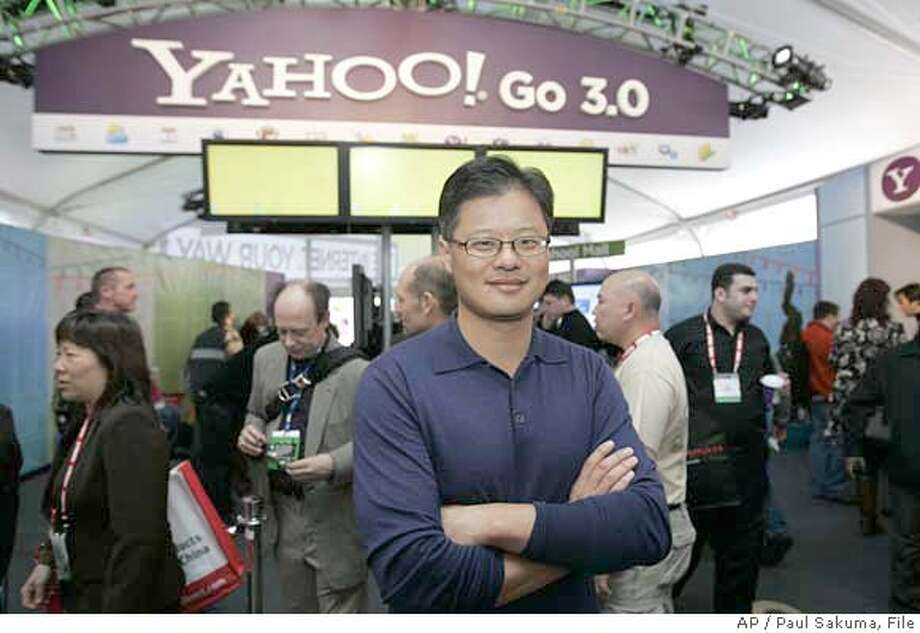 ###Live Caption:** FILE ** Yahoo CEO Jerry Yang poses for a photo in front of the Yahoo booth at the Consumer Electronics Show in Las Vegas in this Jan. 7, 2008 file photo. Tech-industry history shows that the failure of Microsoft and Yahoo to come together on an acquisition could turn out to be brilliant. (AP Photo/Paul Sakuma, file)###Caption History:** FILE ** Yahoo CEO Jerry Yang poses for a photo in front of the Yahoo booth at the Consumer Electronics Show in Las Vegas in this Jan. 7, 2008 file photo. Tech-industry history shows that the failure of Microsoft and Yahoo to come together on an acquisition could turn out to be brilliant. (AP Photo/Paul Sakuma, file)###Notes:###Special Instructions:JAN 7, 2008 FILE PHOTO. Photo: Paul Sakuma