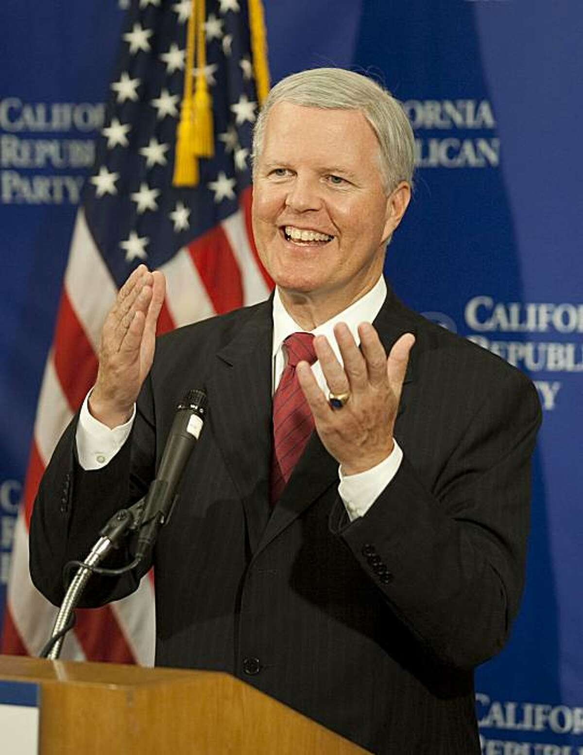Former congressman Tom Campbell speaks at a news conference during the California Republican Convention in Indian Wells, Calif., on Saturday, Sept. 26, 2009. Campbell is seeking the Republican nomination for Governor of California.(AP Photo/Francis Specker)