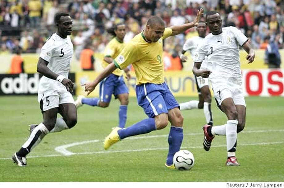 ###Live Caption:adfdf###Caption History:Brazil's Ronaldo kicks the ball as Ghana's John Mensah (L) and Sheila Illiasu (R) watch during their second round World Cup 2006 soccer match against Ghana in Dortmund June 27, 2006. FIFA RESTRICTION - NO MOBILE USE REUTERS/Jerry Lampen (GERMANY)  Ran on: 06-28-2006  Ronaldo of Brazil kicks the ball against the defense of John Mensah (left) and Sheila Illiasu of Ghana.###Notes:###Special Instructions:0 Photo: JERRY LAMPEN