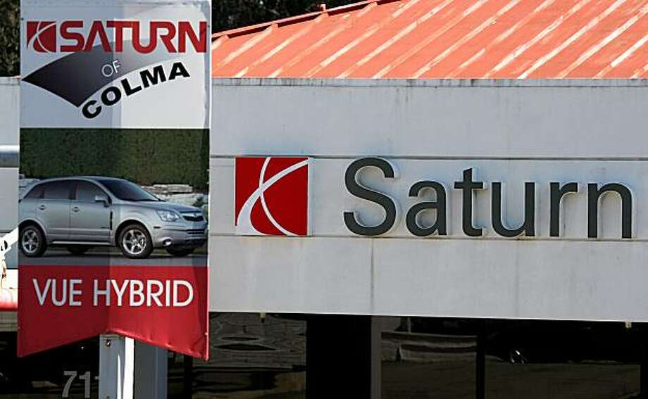 COLMA, CA - SEPTEMBER 30:  Signage remains on the sales lot of the closed Saturn of Colma dealership September 30, 2009 in Colma, California. General Motors announced today that they will close its Saturn brand after negotiations with Penske Automotive to sell the brand fell apart.  (Photo by Justin Sullivan/Getty Images) Photo: Justin Sullivan, Getty Images