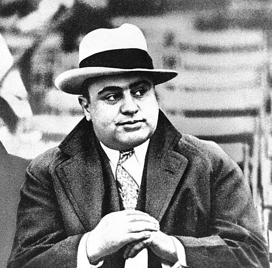 FILE - In this Jan. 19, 1931 file photo, Chicago mobster Al Capone is seen at a football game in Chicago. The buyer of a scenic property in northern Wisconsin will get more than just its bar and restaurant: They'll have a former hideout of Chicago mobster Al Capone. The 407-acre wooded site, complete with guard towers and a stone house with 18-inch-thick walls, goes on the auction block this month at a starting bid of $2.6 million. The bank that foreclosed on the land near Couderay, about 140 miles northeast of Minneapolis, said Capone owned it in the late 1920s and early 1930s during Prohibition.  (AP Photo/File) Photo: Anonymous, AP