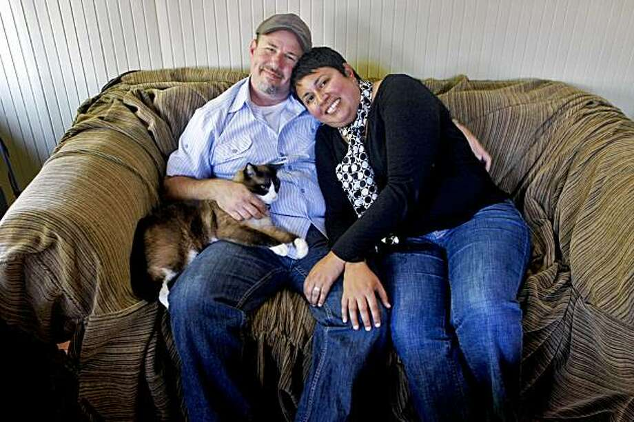 Clark Janklow snuggles with Theresa Singh on their couch, Tuesday Sept. 15,2009, in Alameda, Calif. They are getting married next month. Photo: Lacy Atkins, The Chronicle