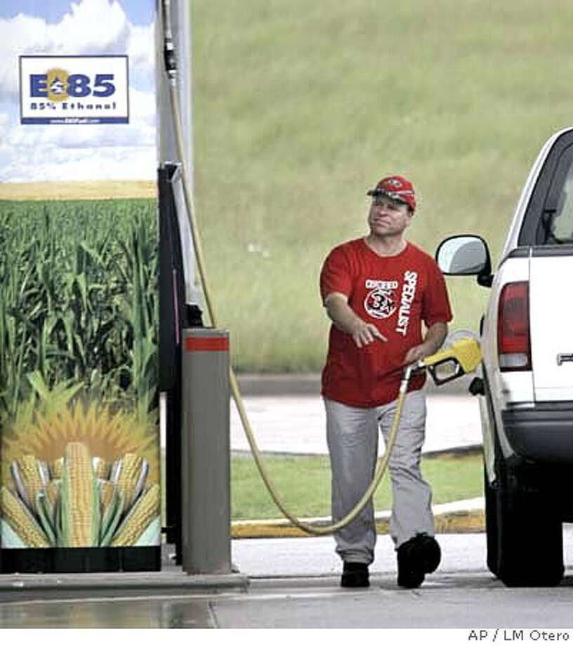 ###Live Caption:A sign on the pump advertises the ethanol content of the gasoline as a motorist reaches for the gas pump in his truck at a filling station in Bellmead, Texas, Tuesday, May 6, 2008. Oil futures blasted to a new record over $122 a barrel Tuesday, gaining momentum as investors bought on a forecast of much higher prices and on any news hinting at supply shortages. (AP Photo/LM Otero)###Caption History:A sign on the pump advertises the ethanol content of the gasoline as a motorist reaches for the gas pump in his truck at a filling station in Bellmead, Texas, Tuesday, May 6, 2008. Oil futures blasted to a new record over $122 a barrel Tuesday, gaining momentum as investors bought on a forecast of much higher prices and on any news hinting at supply shortages. (AP Photo/LM Otero)###Notes:###Special Instructions: Photo: LM Otero