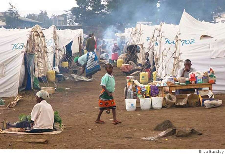 ###Live Caption:Kikuyu refugees from political violence now live in tents in this displacement camp in Nakuru, Kenya. For nearly four months, some 14,000 internally dispaced members of the Kikuyu tribe have lived in a camp outside the Rift Valley town of Nakuru. Though the government has promised that all IDPs will be resettled, few have returned home since violence forced them to flee.###Caption History:Kikuyu refugees from political violence now live in tents in this displacement camp in Kakuru, Kenya.  For nearly four months, some 14,000 internally dispaced members of the Kikuyu tribe have lived in a camp outside the Rift Valley town of Nakuru. Though the government has promised that all IDPs will be resettled, few have returned home since violence forced them to flee.###Notes:###Special Instructions: Photo: By Eliza Barclay Eliza Barclay