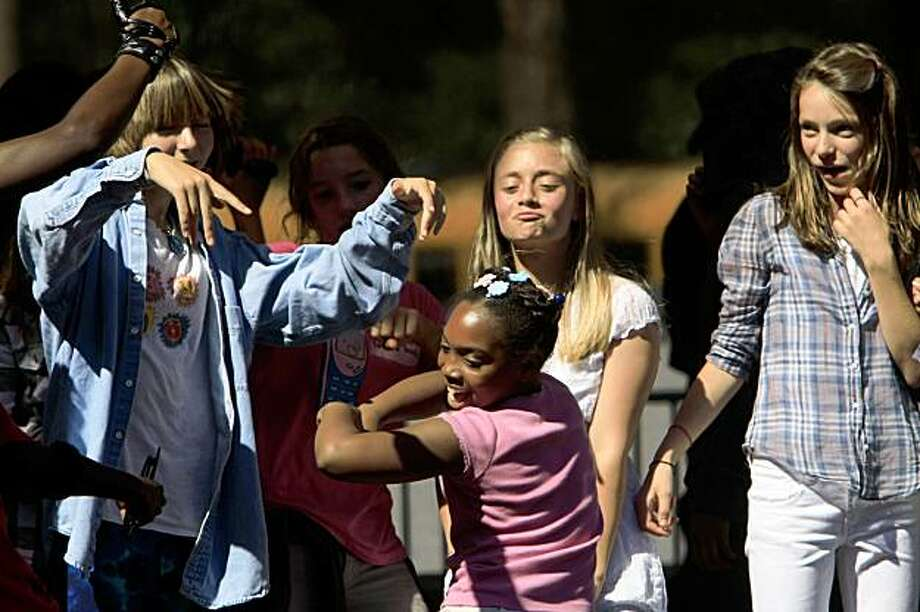 Middle schoolers dance on stage at the MC Hammer concert at the Hardly Strictly Bluegrass Festival in San Francisco's Golden Gate Park on Friday. Photo: Frederic Larson, The Chronicle