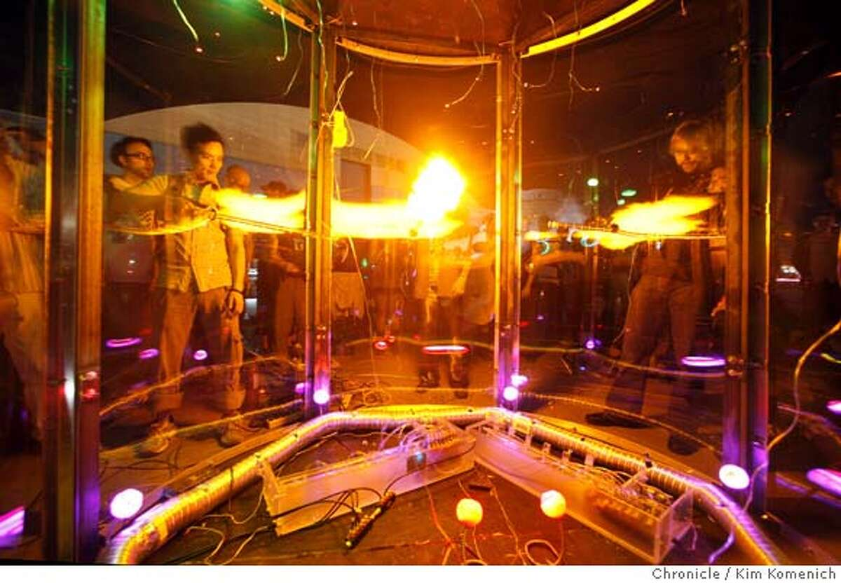 """Festivalgoers play with an interactive """"Hydrogen Chamber"""", designed by Brett Levine and his associates, on Saturday, April 12, 2008 during Yuri's Night"""" at NASA Ames Research Center at Moffett FIeld, Calif. Photo by Kim Komenich / San Francisco Chronicle"""