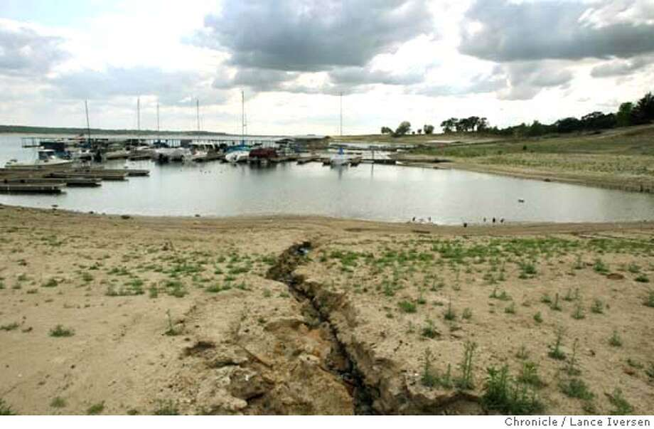 ###Live Caption:Erosions cuts through the beach at Camanche Reservoir Marina on the lakes north shore Wednesday April 23, 2008 Photographed at Camanche Reservoir Calif, Photo By Lance Iversen / San Francisco Chronicle###Caption History:Erosions cuts through the beach at Camanche Reservoir Marina on the lakes north shore Wednesday April 23, 2008 Photographed at Camanche Reservoir Calif, Photo By Lance Iversen / San Francisco Chronicle###Notes:Lance Iversen 415-2979395  CQ###Special Instructions:MANDATORY CREDIT PHOTOG AND SAN FRANCISCO CHRONICLE. Photo: LANCE IVERSEN