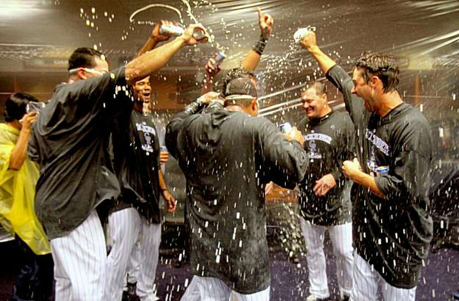 DENVER - OCTOBER 01:  The Colorado Rockies shower each other with beer and champagne as celebrate in the clubhouse after they defeated the Milwaukee Brewers 9-2 and clinched a National League playoff berth at Coors Field on October 1, 2009 in Denver, Colorado.  (Photo by Doug Pensinger/Getty Images) Photo: Doug Pensinger, Getty Images