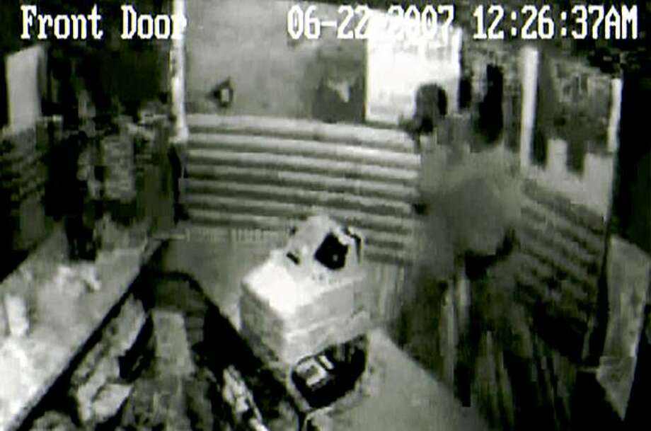 In this image rendered from a security video that is evidence in a federal lawsuit, Eric Arriaga, second from right, is shown being grabbed from behind by Texas Alcoholic Beverage Commission agent Jeff Rendon at the Cactus Canyon bar in Victoria, Texas, June 22, 2007. Based on the video, an assistant district attorney declined to prosecute the patron for resisting arrest, but the TABC decided that the agent didn't do anything wrong. Rendon has three excessive-force allegations since he joined the agency in 2004. (AP Photo) Photo: AP