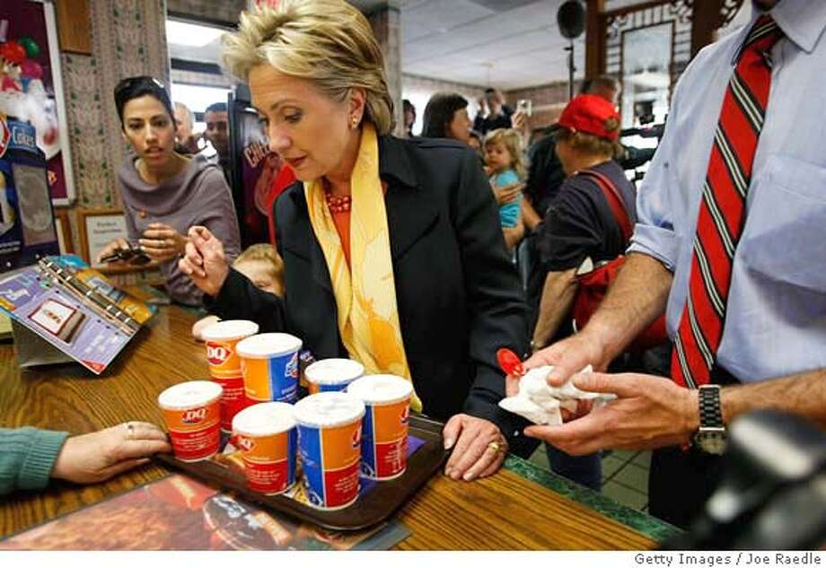 ###Live Caption:SOUTH BEND, IN - MAY 04: Democratic presidential hopeful U.S. Senator Hillary Clinton (D-NY) looks at the Blizzard's she ordered for herself and staff at a Dairy Queen May 4, 2008 in South Bend, Indiana. Clinton and Sen. Barack Obama (D-IL) are each hoping to win the state's primary on May 6 as the Democrats battle for their parties' presidential nomination. (Photo by Joe Raedle/Getty Images)###Caption History:SOUTH BEND, IN - MAY 04: Democratic presidential hopeful U.S. Senator Hillary Clinton (D-NY) looks at the Blizzard's she ordered for herself and staff at a Dairy Queen May 4, 2008 in South Bend, Indiana. Clinton and Sen. Barack Obama (D-IL) are each hoping to win the state's primary on May 6 as the Democrats battle for their parties' presidential nomination. (Photo by Joe Raedle/Getty Images)###Notes:Hillary Clinton Campaigns Ahead Of Indiana And North Carolina Primaries###Special Instructions: Photo: Joe Raedle