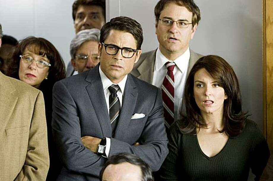 "In this film publicity image released by Warner Bros., Rob Lowe, and Tina Fey, right, are shown in a scene from, ""The Invention of Lying."" (AP Photo/Warner Bros., Sam Urdank) Photo: Sam Urdank, AP"