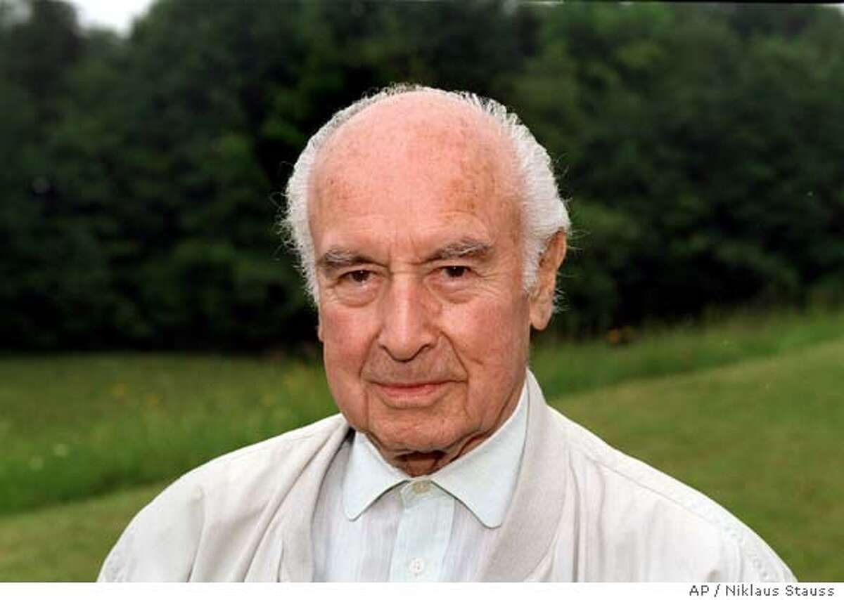 ** FILE ** In this undated file photo, Swiss chemist Albert Hofmann is seen in his garden in Burg, Switzerland. Hofmann, the discoverer of LSD, has died aged 102, officials of the town of Burg, Switzerland, confirmed. (AP Photo/Keystone, Niklaus Stauss) ** NO SALES NO ARCHIVES ONE TIME USE ONLY **