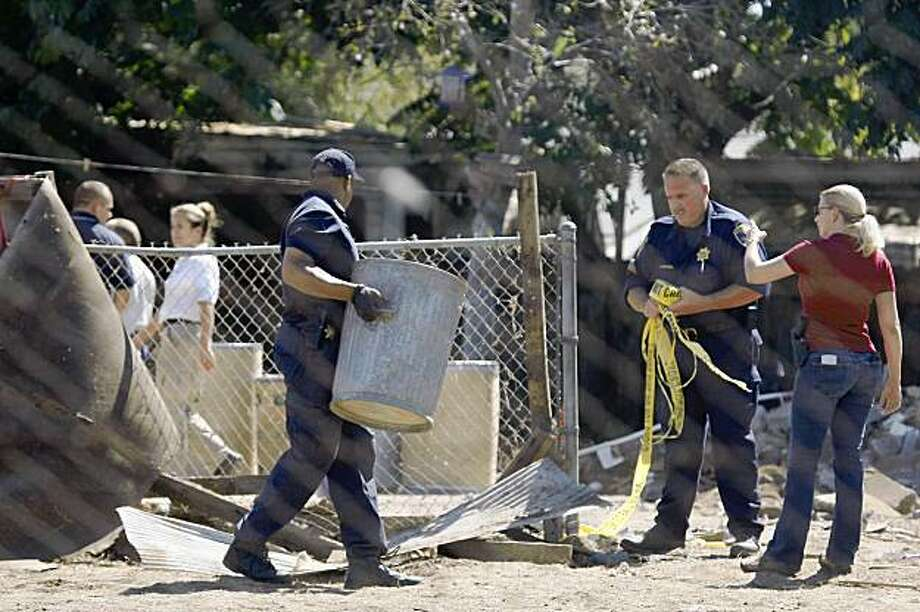 Investigators collect equipment from Garrido's yard and a neighbor's yard where they had been searching and digging in Antioch, Calif. on Tuesday, September 22, 2009 in search of evidence relating to the abduction of 9-year-old Michaela Garecht of Hayward in 1988 and 13-year-old Ilene Misheloff of Dublin in 1989. Photo: Lea Suzuki, The Chronicle