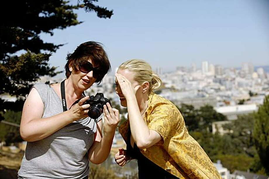 Julie Michelle, left, and Claire Cochran look over some of the photos that Michelle took of Cochran in Corona Heights Park in San Francisco, Calif. on Friday, Sept. 11, 2009. Photo: Russell Yip, The Chronicle