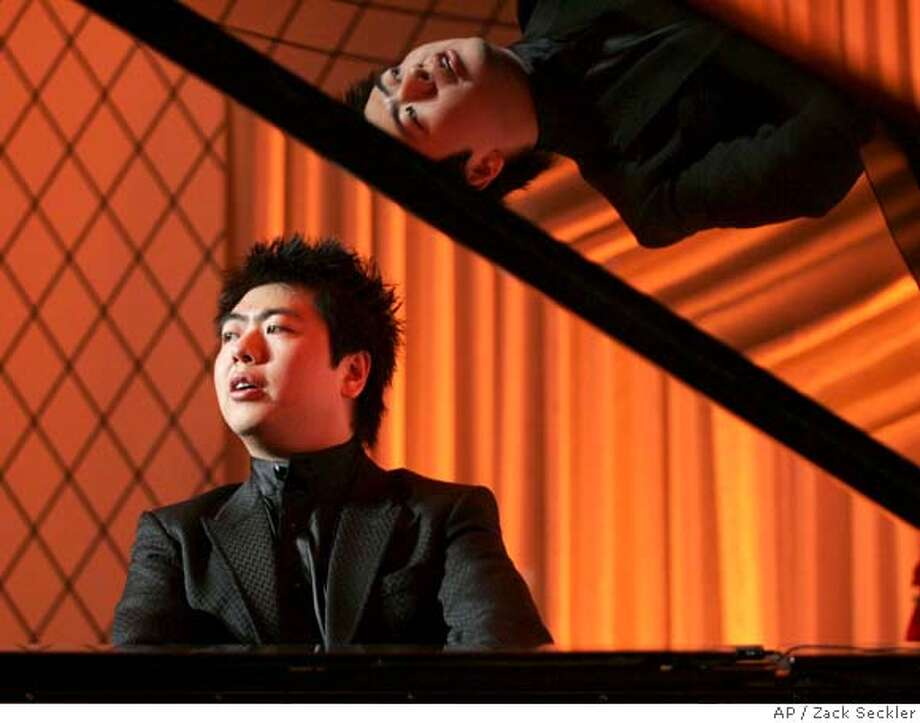 In a photo provided by Sony, pianist Lang Lang plays during a private performance in New York April 10, 2008, at an event held to announce Sony's three year sponsorship of the pianist. (AP Photo/Zack Seckler/SONY)** NO SALES ** Photo: Zack Seckler