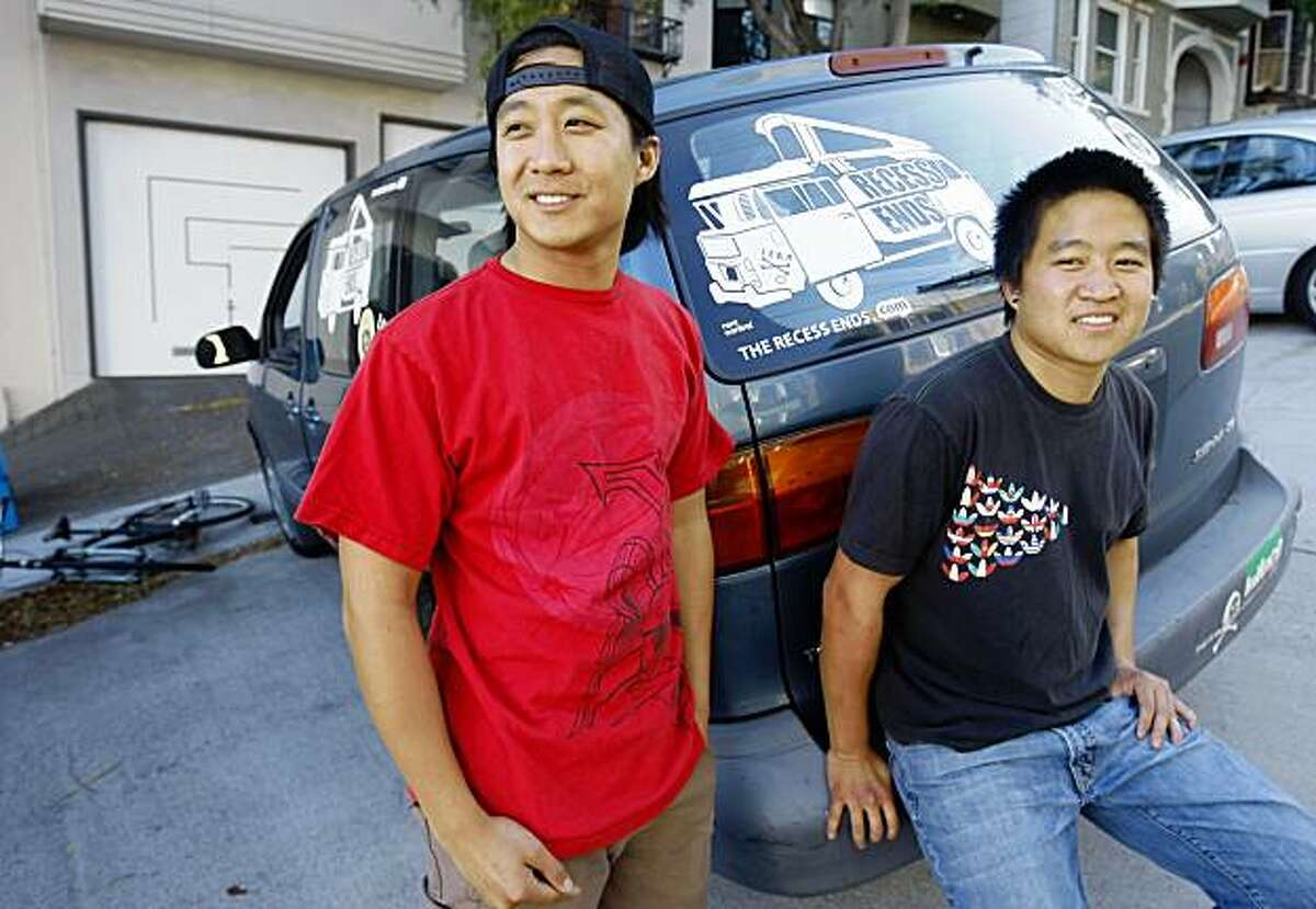 Austin and Brian Chu pose with the Dodge minivan, Thursday Sept. 17, 2009, in San Francisco, Calif. After Austin lost his job he talked his brother Brian into traveling all 50 states to film the recession. Their documentary