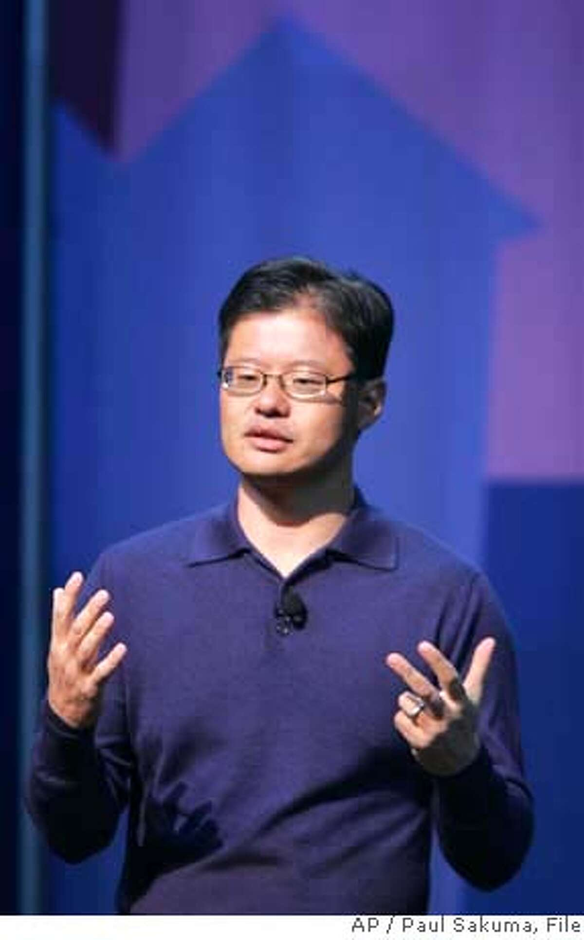 ###Live Caption:** FILE ** Yahoo CEO Jerry Yang gives a keynote address at the Consumer Electronics Show (CES) in Las Vegas, in this Jan. 7, 2008 file photo. Yahoo Inc. Chief Executive Jerry Yang told employees Wednesday Feb. 6, 2008, that the struggling Internet pioneer is still examining ways to avoid a takeover by rival Microsoft Corp. (AP Photo/Paul Sakuma, file)###Caption History:** FILE ** Yahoo CEO Jerry Yang gives a keynote address at the Consumer Electronics Show (CES) in Las Vegas, in this Jan. 7, 2008 file photo. Yahoo Inc. Chief Executive Jerry Yang told employees Wednesday Feb. 6, 2008, that the struggling Internet pioneer is still examining ways to avoid a takeover by rival Microsoft Corp. (AP Photo/Paul Sakuma, file) Ran on: 02-10-2008 After spurning Microsofts merger offer, Yahoo will remain in its current form and headquarters. Ran on: 02-10-2008 After spurning Microsofts merger offer, Yahoo will remain in its current form and headquarters. Ran on: 05-04-2008 Steve Ballmer Ran on: 05-04-2008 Steve Ballmer###Notes:Jerry Yang###Special Instructions:A JAN. 7, 2008 FILE PHOTO.