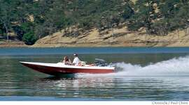 ###Live Caption: A power boat glides along the water of Lake Berryessa. A tour of the lake by Department of Reclamation officials on 8/7/03 in Lake Berryessa. ###Caption History: berryessa118_pc.jpg A power boat glides along the water of Lake Berryessa. A tour of the lake by Department of Reclamation officials on 8/7/03 in Lake Berryessa. PAUL CHINN / The Chronicle Lake Berryessa has been a mecca for water skiers and power boaters for many years. Paddlers want more access. ProductName	Chronicle ProductName	Chronicle ProductName	Chronicle ###Notes: full ###Special Instructions: MANDATORY CREDIT FOR PHOTOG AND SF CHRONICLE/NO SALES-MAGS OUT