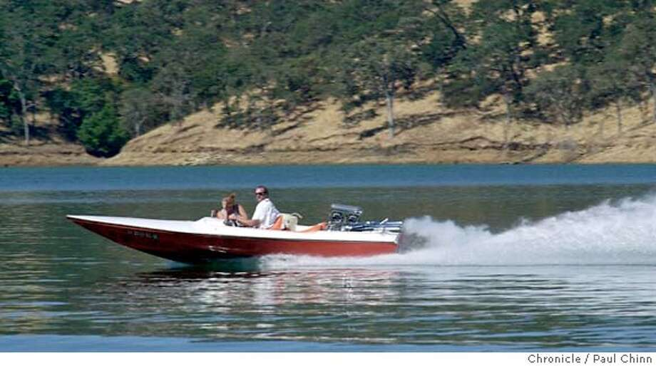###Live Caption:A power boat glides along the water of Lake Berryessa. A tour of the lake by Department of Reclamation officials on 8/7/03 in Lake Berryessa.###Caption History:berryessa118_pc.jpg A power boat glides along the water of Lake Berryessa. A tour of the lake by Department of Reclamation officials on 8/7/03 in Lake Berryessa. PAUL CHINN / The Chronicle Lake Berryessa has been a mecca for water skiers and power boaters for many years. Paddlers want more access. ProductNameChronicle ProductNameChronicle ProductNameChronicle###Notes:full###Special Instructions:MANDATORY CREDIT FOR PHOTOG AND SF CHRONICLE/NO SALES-MAGS OUT Photo: PAUL CHINN