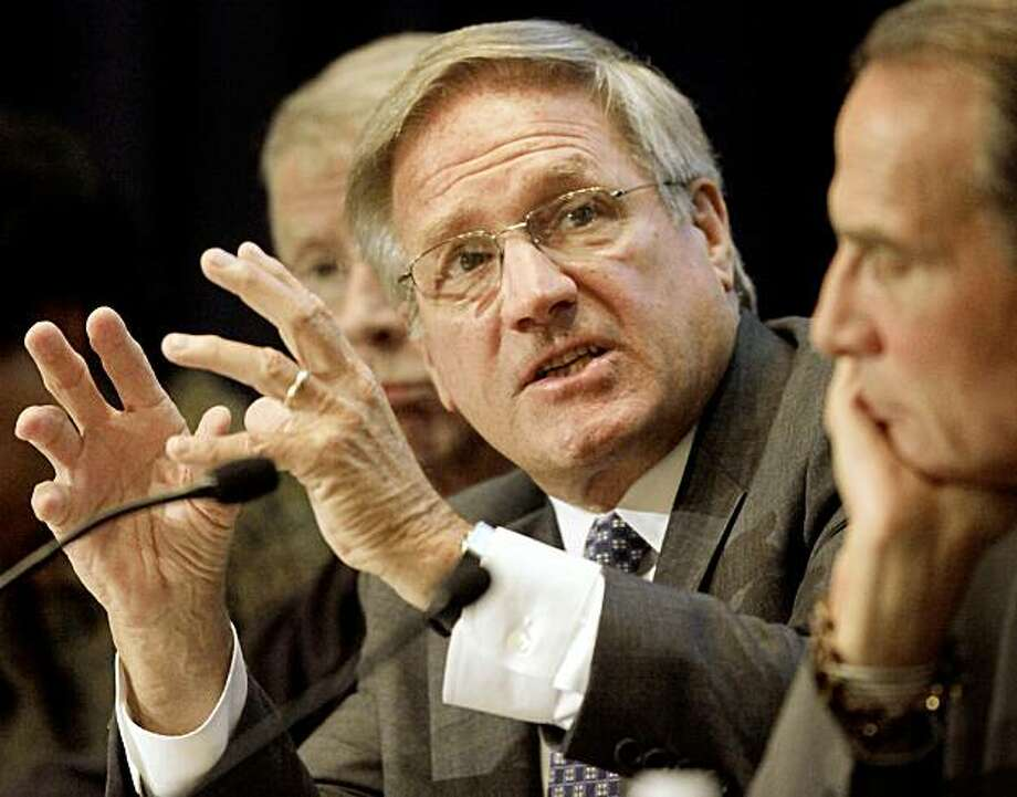 """Former Massachusetts Attorney General Scott Harshbarger, center, addresses an audience during a symposium called """"Massachusetts Superior Court 150 Years of the Rule of Law"""" at the Boston Public Library, in Boston, Tuesday, Sept. 22, 2009. The community activist group ACORN said it has selected him to investigate its housing program and other public service projects after employees were caught on video giving advice to a couple posing as a prostitute and pimp and Congress moved to cut off its federal funding. (AP Photo/Steven Senne) Photo: Steven Senne, AP"""
