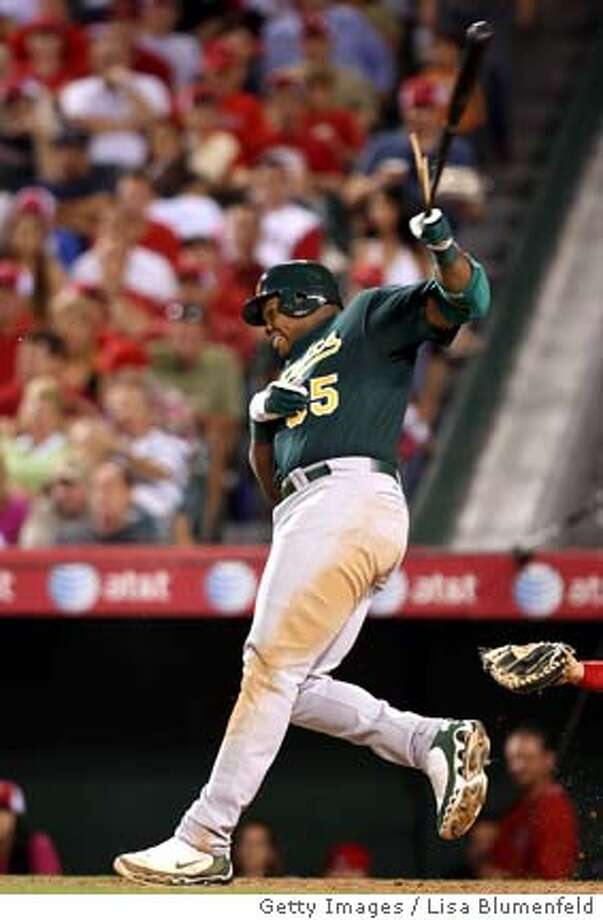 ANAHEIM, CA - APRIL 28: Frank Thomas #35 of the Oakland Athletics hits a RBI single in the fifth inning against the Los Angeles Angels of Anaheim at Angels Stadium on April 28, 2008 in Anaheim, California. (Photo by Lisa Blumenfeld/Getty Images)  Ran on: 04-29-2008  Frank Thomas shows some lift, while splintering an RBI single in the fifth inning -- after a triple in the first. Photo: Lisa Blumenfeld
