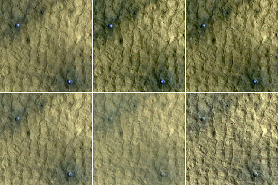 This series of images, taken by NASA's Mars Reconnaissance Orbiter and spanning a period of 15 weeks, shows a pair of fresh, middle-latitude craters on Mars in which some bright, bluish material apparent in the earliest images disappears by the later ones. The bright material is water ice that was uncovered by the meteorite impact that excavated these small craters less than 15 weeks before the initial image of this series. Sublimation of the ice during the Martian summer leaves behind a dust layer that gradually thickens to the point where it obscures the ice. Photo: NASA/JPL-Caltech, University Of Arizona