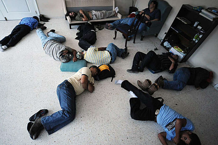 Supporters of ousted Honduran President Manuel Zelaya sleep at a room contiguous to his, at the Brazilian Embassy in Tegucigalpa, on September 25, 2009. Honduras' de facto leader and ousted President Manuel Zelaya have agreed to start dialogue, in a first break of a tense political impasse here since Zelaya's surprise return home five days ago. Zelaya, who is holed up in the Brazilian embassy, said a dialogue had begun with the de facto government to seek a peaceful end to the crisis set off by his June 28 ousting. Photo: Orlando Sierra, AFP/Getty Images