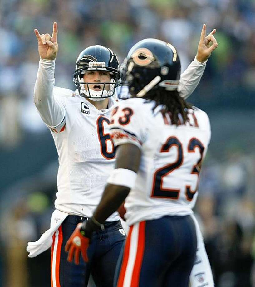 Chicago Bears' Jay Cutler, left, signals after Devin Hester, right, scored a touchdown in the fourth quarter against the Seattle Seahawks in an NFL football game Sunday, Sept. 27, 2009, in Seattle. The Bears scored on a 2-point conversion, and beat the Seahawks 25-19. (AP Photo/John Froschauer) Photo: John Froschauer, AP