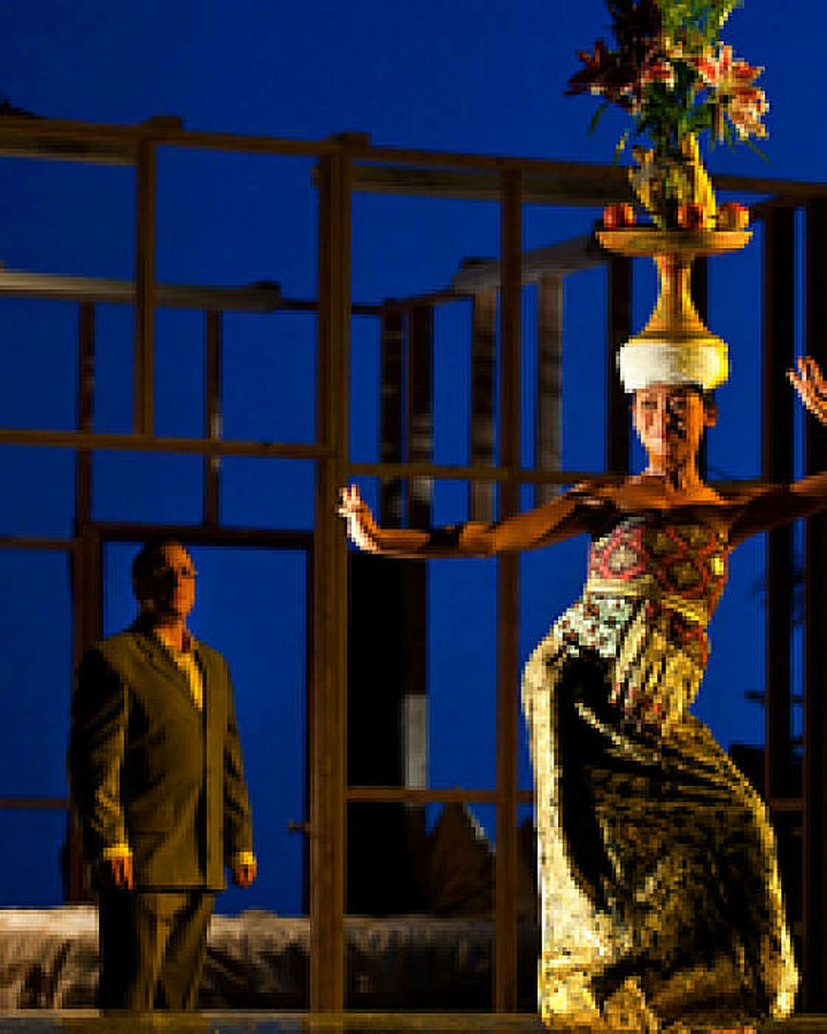 Haute-contre Marc Molomot and dancer/choreographer Kadek Dewi Aryani in Evan Ziporyn's new opera A House in Bali, the American premiere is presented by Cal Performances on September 26 & 27, 2009.