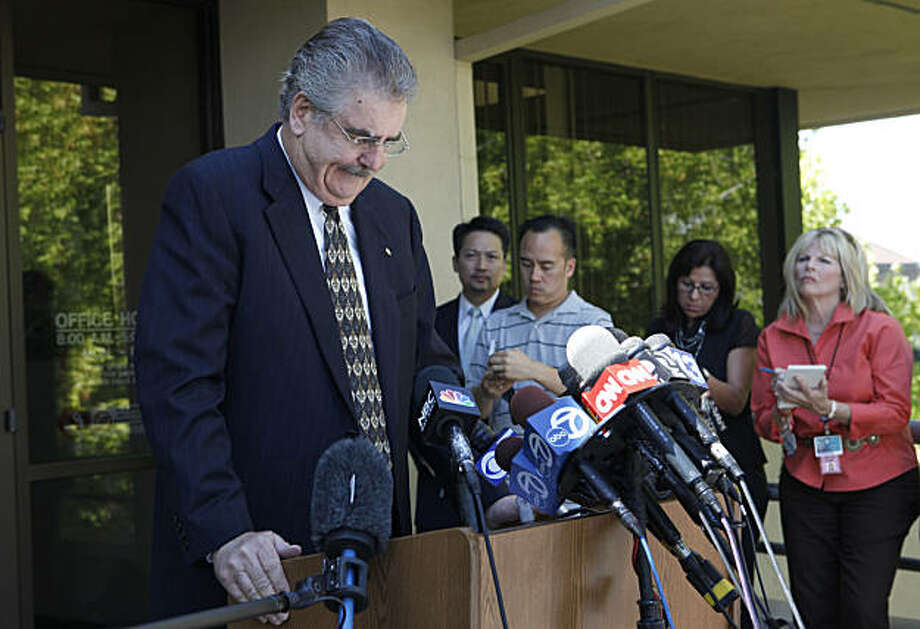 Conta Costa County Sheriff Warren E. Rupf, left, speaks at a news conference discussing contact the Sheriff's Office had with kidnap suspect Phillip Garrido in 2006 on Tuesday, Aug. 28, 2009, in Martinez, Calif. A woman who was snatched from a bus stop as an 11-year-old child in 1991 turned up Thursday after being held for the past 18 years in isolation in a backyard compound by a convicted sex offender who fathered two children with her, police said. (AP Photo/Jeff Chiu) Photo: Jeff Chiu, AP