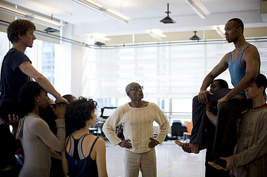 Choreographer Bill T. Jones, center, rehearsing with his company in New York in August 2009. Jones is fond of saying that when he was growing up, Abraham Lincoln was the one white man he was allowed to love unconditionally. Sometimes he includes John F. Kennedy and his brother Robert as well. It's a catchy sound bite, and it has served Jones well over the last two years, as he has undertaken one of the most ambitious and challenging projects of an ambitious and challenging career: a commission by the Ravinia Festival in Illinois to create a dance-theater work celebrating the bicentennial of Lincoln's birth. (Todd Heisler/The New York Times) Photo: Todd Heisler, NYT
