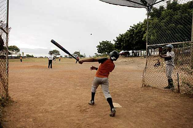 In the land where baseball is king, Dominican Republic youth practice for hours everyday on dusty, trash-ridden fields. Photo: Carlos Avila Gonzalez, The Chronicle