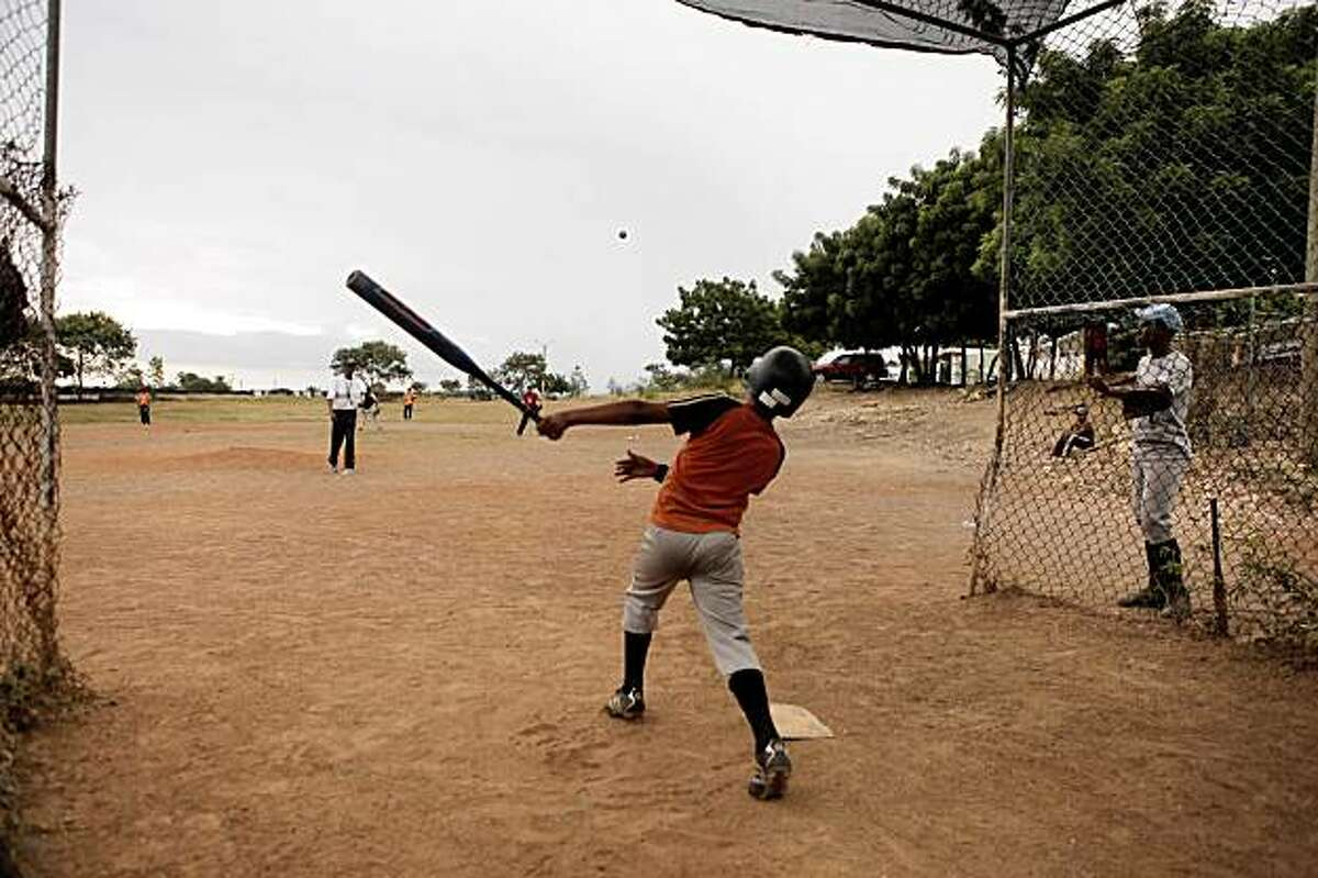 In the land where baseball is king, Dominican Republic youth practice for hours everyday on dusty, trash-ridden fields.