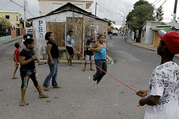 Neighborhood children play on the same streets where Angel Villalona played baseball as a child in one of the poorest neighrborhoods in La Romana. Photo: Carlos Avila Gonzalez, The Chronicle