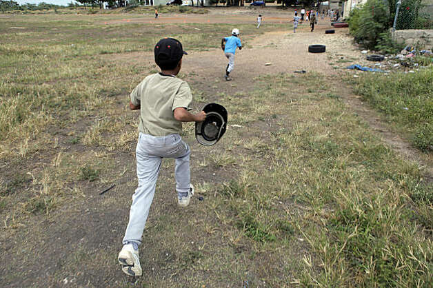 Kids take the field where Angel Villalona used to train. Photo: Carlos Avila Gonzalez, The Chronicle
