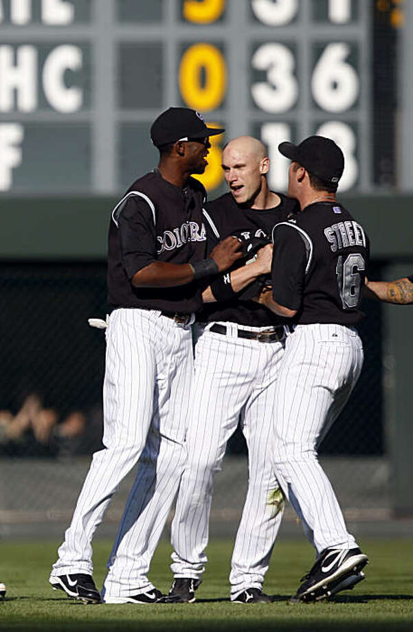 Colorado Rockies second baseman Clint Barmes, center, is congratulated by outfielder Dexter Fowler, left, and relief pitcher Huston Street after Barmes caught a pop fly by St. Louis Cardinals' Ryan Ludwick and turned it into a double play to finish off the Rockies' 4-3 victory in in a baseball game in Denver on Sunday, Sept. 27, 2009. (AP Photo/David Zalubowski) Photo: David Zalubowski, AP