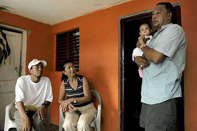 The family of Mario de Jesus Velete, speaks to the media from their home in La Romana, after the murder on Sept. 19. Photo: Carlos Avila Gonzalez, The Chronicle