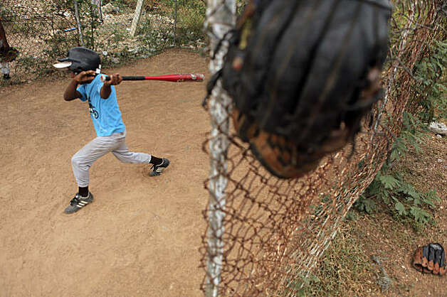 A batter takes a swing on the same field where Angel Villalona used to hit. Photo: Carlos Avila Gonzalez, The Chronicle