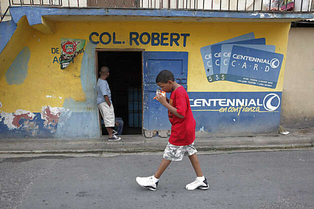Neighborhood children walk the same streets where Angel Villalona played baseball as a child in one of the poorest neighrborhoods in La Romana. Photo: Carlos Avila Gonzalez, The Chronicle