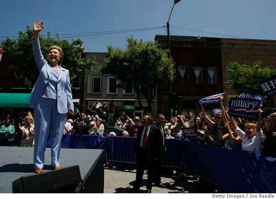 ###Live Caption:HENDERSONVILLE, NC - MAY 02: Democratic presidential hopeful Sen. Hillary Clinton (D-NY) waves during a campaign event in front of the Henderson county court house May 2, 2008 in Hendersonville, North Carolina. Clinton and Sen. Barack Obama (D-IL) are each hoping to win the state's primary on May 6 as the Democrats battle for their parties' presidential nomination. (Photo by Joe Raedle/Getty Images)###Caption History:HENDERSONVILLE, NC - MAY 02: Democratic presidential hopeful Sen. Hillary Clinton (D-NY) waves during a campaign event in front of the Henderson county court house May 2, 2008 in Hendersonville, North Carolina. Clinton and Sen. Barack Obama (D-IL) are each hoping to win the state's primary on May 6 as the Democrats battle for their parties' presidential nomination. (Photo by Joe Raedle/Getty Images)###Notes:Hillary Clinton Campaigns Ahead Of Indiana And North Carolina Primaries###Special Instructions: Photo: Joe Raedle