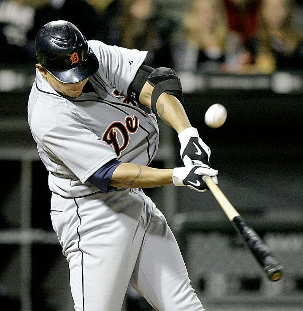 Detroit Tigers' Miguel Cabrera singles off Chicago White Sox relief pitcher Scott Linebrink scoring Clete Thomas during the eighth inning of a baseball game Saturday, Sept. 26, 2009 in Chicago. (AP Photo/Charles Rex Arbogast)