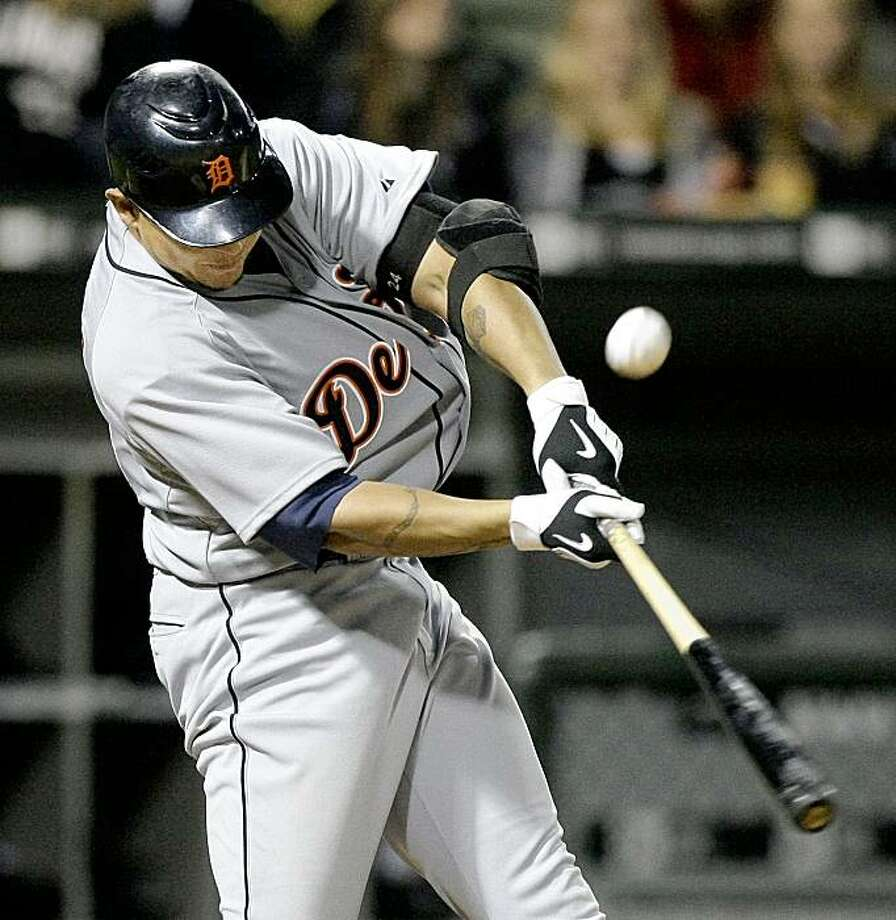 Detroit Tigers' Miguel Cabrera singles off  Chicago White Sox relief pitcher Scott Linebrink scoring Clete Thomas during the eighth inning of a baseball game Saturday, Sept. 26, 2009 in Chicago. (AP Photo/Charles Rex Arbogast) Photo: Charles Rex Arbogast, AP