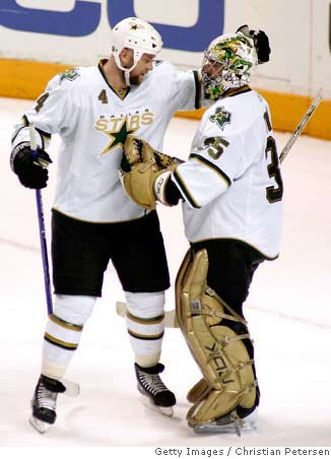 ###Live Caption:SAN JOSE, CA - APRIL 27: Goaltender Marty Turco #35 of the Dallas Stars is congratulated by teammate Mattias Norstrom #4 after defeating the San Jose Sharks in Game 2 of the Western Conference Semifinals of the 2008 NHL Stanley Cup Playoffs at HP Pavilion April 27, 2008 in San Jose, California. The Stars defeated the Sharks 5-2 to make the series 2-0. (Photo by Christian Petersen/Getty Images)###Caption History:SAN JOSE, CA - APRIL 27: Goaltender Marty Turco #35 of the Dallas Stars is congratulated by teammate Mattias Norstrom #4 after defeating the San Jose Sharks in Game 2 of the Western Conference Semifinals of the 2008 NHL Stanley Cup Playoffs at HP Pavilion April 27, 2008 in San Jose, California. The Stars defeated the Sharks 5-2 to make the series 2-0. (Photo by Christian Petersen/Getty Images)###Notes:Dallas Stars v San Jose Sharks - Game Two###Special Instructions: Photo: Christian Petersen