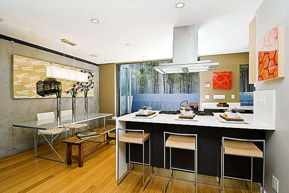 A look at the joined kitchen and dining area. Photo: OpenHomesPhotography.com