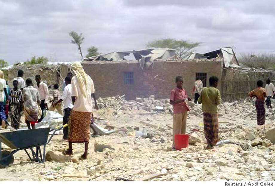 ###Live Caption:People walk through rubble after U.S. war planes killed an Islamist rebel said to be al Qaeda's leader in Somalia and as many as 30 other people in Dusamareb, May 1, 2008. The rebels said Aden Hashi Ayro -- who led al Shabaab militants blamed for attacks on government troops and their Ethiopian allies -- died in the first major success for a string of U.S. air-strikes on Somali insurgents in the last year. REUTERS/Abdi Guled (SOMALIA)###Caption History:People walk through rubble after U.S. war planes killed an Islamist rebel said to be al Qaeda's leader in Somalia and as many as 30 other people in Dusamareb, May 1, 2008. The rebels said Aden Hashi Ayro -- who led al Shabaab militants blamed for attacks on government troops and their Ethiopian allies -- died in the first major success for a string of U.S. air-strikes on Somali insurgents in the last year. REUTERS/Abdi Guled (SOMALIA)###Notes:People walk through rubble after U.S. war planes killed an Islamist rebel said to be al Qaeda's leader in Somalia and as many as 30 other people in Dusamareb###Special Instructions:0 Photo: STR