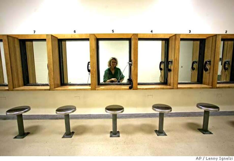 ###Live Caption:Susan Marie Lefevre, now known as Marie Walsh, sits alone in the prisoners- visitors area at the Las Colinas Detention Facility Wednesday, April 30, 2008 in Santee, Calif. Lefevre, who escaped from a Michigan prison in 1976 and has spent two decades married and raising three children, was arrested by federal authorities April 24. (AP Photo/Lenny Ignelzi)###Caption History:Susan Marie Lefevre, now known as Marie Walsh, sits alone in the prisoners- visitors area at the Las Colinas Detention Facility Wednesday, April 30, 2008 in Santee, Calif. Lefevre, who escaped from a Michigan prison in 1976 and has spent two decades married and raising three children, was arrested by federal authorities April 24. (AP Photo/Lenny Ignelzi)###Notes:Susan Marie Lefevre###Special Instructions: Photo: Lenny Ignelzi
