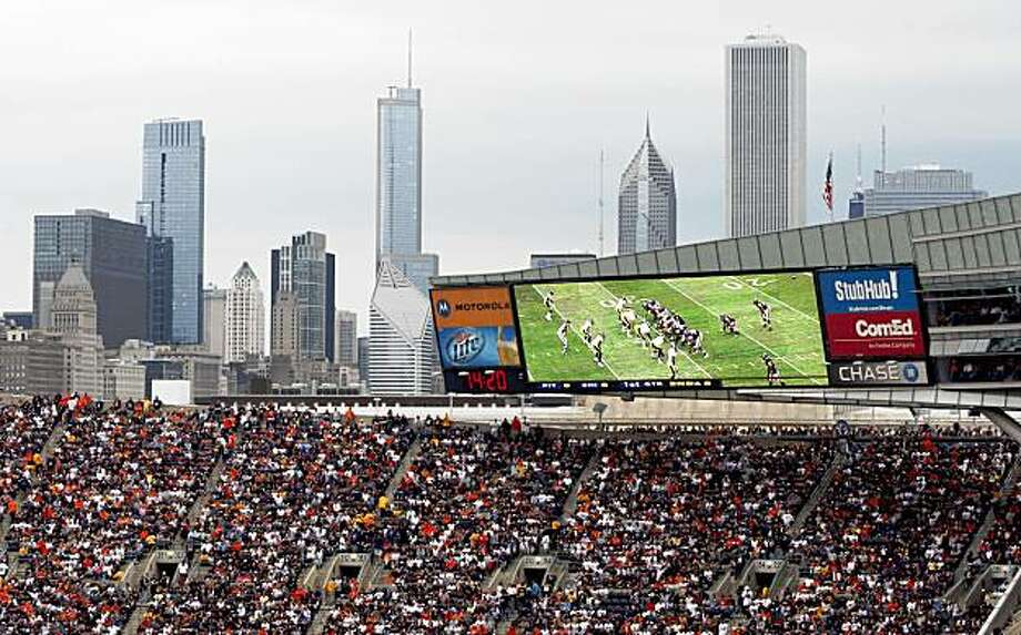 In this photo taken on Sept. 20, 2009, fans pack Chicago's Soldier Field to watch at Chicago Bears take on the Pittsburgh Steelers during an NFL football game. U.S. counterterrorism officials have issued security bulletins on Monday, Sept. 21, 2009, about terrorist interest in attacking sports stadiums, entertainment complexes and hotels. (AP Photo/Kiichiro Sato) Photo: Kiichiro Sato, AP
